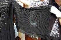 Image of Pleated sleeve of black evening dress