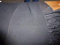 Image of Moth damage on black evening dress