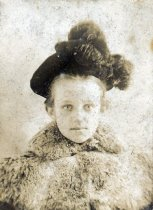 Image of girl in a fur hat