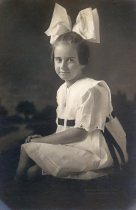 Image of girl with large bow in hair