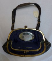 Image of Black leather purse with brass clasp, interior