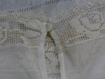 Image of White lawn dress detail, buttons