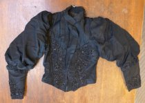 Image of Black beaded jacket with puffed sleeves