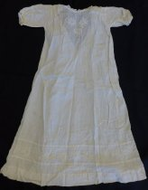 Image of White cotton baby dress with embroidered flowers