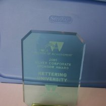 Image of Kettering University - A YMCA Women of Achievement Award. (2005) Made out of glass with a wooden base.