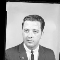 Image of AC Sparkplug - 65-15452) Two black and white film negative images of portrait of Bobby G. Williamson in a suit, tie with tie tack, and lapel pin on right lapel.Both images similar with slight variation between them.