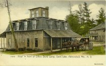 Image of 51573 Stage in front of Office Darts Camp, Darts Lake, Adirondack Mts., N.Y. - Postcard
