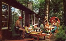 Image of Enjoying the Sun on a Cottage Terrace at the Mohawk, Fourth Lake, Old Forge, New York - Postcard