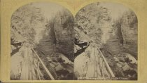 Image of 588. The Long Gallery, Ausable Chasm. - photo - stereo; mounted; sepia