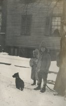 Image of Woman, Children, and Dog by House - Print, Photographic