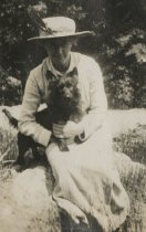 Image of Woman with Dog on Lap - Print, Photographic