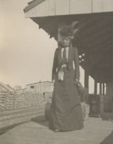 Image of Woman on Station Platform - Print, Photographic