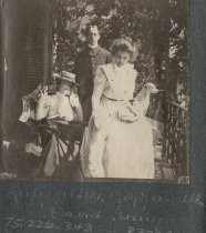 Image of Women, Man, and Dogs on Porch - Print, Photographic