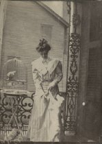 Image of Woman, Dogs, and Parrot - Print, Photographic