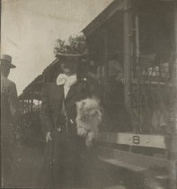 Image of Woman with Dog by Streetcar - Print, Photographic