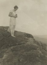 Image of Woman on Unidentified Mountain Summit - Print, Photographic
