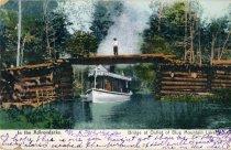 Image of In the Adirondacks, Bridge at Outlet of Blue Mountain lake - Postcard