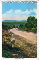 Image of View from State Highway approaching Blue Mountain Lake Village, Blue Mountain Lake and Blue Ridge in distance - Postcard