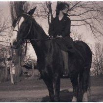 Image of Elizabeth Hillmer on horse at Geddes farm, 1920s or 1930s