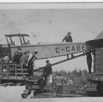 Image of C-CABE airplane on railroad and cart
