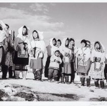Image of Hunter, George - Women in their attigis, await yearly arrival of HBC supply ship, 'RMS Nascopie', Pangnirtung, 1946