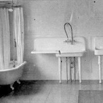 Image of Mueller Co. plumbing fixtures in bathroom--3 sinks, tub and toilet