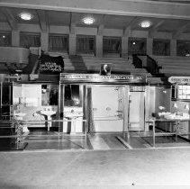 Image of Mueller Co. display of sinks, tubs  1935?