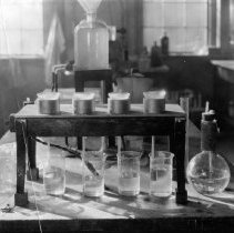 """Image of Photo from booklet """" The Story of Faucets """"  Lab in factory"""