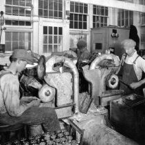 "Image of Photo from booklet "" The Story of Faucets ""  young men grinding in factory"