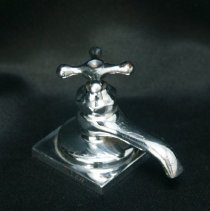 Image of novelty - Paperweight of Mueller faucet
