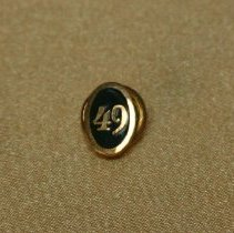 Image of Pin, fraternal - Gold pin with 49 on it.