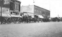 Image of horse and artilery parade on Grand Ave.
