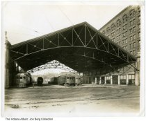 Image of Traction Terminal Shed, Indianapolis, Indiana, 1921 - View looking north from W. Market Street into the Traction Terminal Shed with nine tracks and multiple interurban cars. The Traction Terminal Building is to the right. Numbered 73323-F.