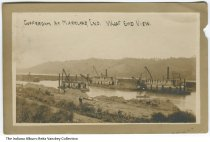 """Image of Postcard of Markland Dam construction, Markland, Indiana, ca.1914 - Photo showing several men at work, and cranes on barges in the Ohio River during the construction of the Markland Dam. The caption on this image reads """"Gofferdam at Markland, Ind. West End View.""""  Postmarked August 11, 1914.  The donor's great-great-grandfather, Christian Henry Brameier, owned a large farm in the area where the dam was built. He sold part of his land to build the dam."""