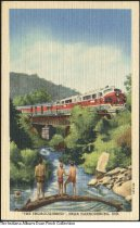"""Image of Postcard of the Thoroughbred Train, Harrodsburg Township, Indiana, ca. 1940 - Postcard of several boys watching the Monon train called """"The Thoroughbred"""" pass over a bridge near Harrodsburg Township."""