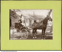 Image of Photo of Harry and Alice Foulke in horse-drawn carriage, Indiana, ca. 1905 - This photo of Harry Edward Foulke and Alice Maude (Addy) Foulke was taken not long after their marriage on February 1, 1905. They farmed near Brazil, Indiana; their first three children were born in Clay County. Between 1912-1918 they moved to western Wayne County between Millville and Hagerstown. In the background is a board and batten sided house.