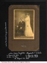 Image of Wedding photograph of John Singleton and Elizabeth Schele, Fort Wayne, Indiana, 1909 - Studio portrait by Ed. Perrey of Fort Wayne of John Marie or Michael Singleton (1882-1952) and Elizabeth T. Schele (1883-1969). The bride wears a white wedding dress and veil.