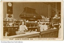 """Image of Interior of """"Pop"""" June's Marine Inn, Indianapolis, Indiana, ca. 1910 - Servers and staff behind a counter inside the restaurant known for its oysters. Postmarked December 7, 1910."""