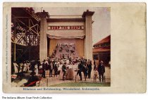 """Image of Postcard of """"Bump the Bumps"""" at Wonderland, Indianapolis, Indiana, ca. 1906 - Postcard showing a group of people on and near a large slide called """"Bump the Bumps."""" It reads """"Hilarious and Exhilarating, Wonderland, Indianapolis."""" The postcard has a copyright date of 1906 on front."""