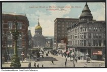 Image of Postcard of West Market Street, Indianapolis, Indiana, ca. 1911 - Postcard looking west on West Market Street from Monument Circle. The Indiana State House is seen in the background and the English Hotel and Opera House is to the right. Signs are visible for the Bates Hotel, Burton Jewelry, Robert E. Gregg Company, and the Royal Bar. Postmarked 1911.