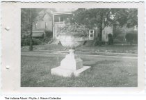 Image of Houses in Woodruff Place, Indianapolis, Indiana, ca. 1951 - One of several snapshots taken by a woman who rented an apartment in 828 Middle Drive in Woodruff Place in about 1951. It depicts two houses and a flower urn in a median.
