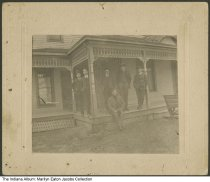 Image of Photo of 6 men on Oliver house porch, Urbana, Indiana, ca. 1910 - The only identified person is Ralph Oliver. This was the home of Tom and Mary Oliver; it was located east of Urbana. As of 2015, the house was still standing.