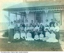 Image of Photograph of Women's Missionary Society, probably Wabash County, Indiana, 1907 - Members of the WMS (probably the Women's Missionary Society) pose in 1907 for local amateur photographer Ralph Harter Oliver, the lender's grandfather. His mother, Mary Francis (Harter) Oliver, is in the back row, center with polka dot top. This was probably taken near Urbana in Wabash County. A tent with a skylight is set-up adjacent to the house.