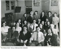Image of United States Rubber Company employees, Indianapolis, Indiana, ca. 1944 - World War II-era employee group portrait at the United States Rubber Company in Indianapolis (renamed Uniroyal, Inc. in 1961). War propaganda posters line the walls. Barbara Ward Utterback (back row, 2nd from right) made bicycle tire tubes during World War II. The company was located near  the Milano Inn on S. College Avenue.