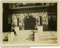 "Image of Snapshot of the Indiana State Normal School ""Old Main"" entrance, Terre Haute, Indiana, ca. 1918 - Three women sit at the entrance to the Indiana State Normal School building known as Old Main. The date stone reads 1888."