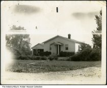 Image of House and garage, 6533 E. 42nd Street, Indianapolis, Indiana, ca. 1930 - House and garage owned by Lawrence and Clara (Fipps) Henderson after they moved to Indianapolis from Orleans, Indiana in the 1920s. This view shows the north side of the home.
