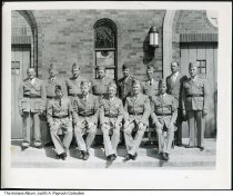 Image of Veterans group at St. Hedwig Church, Gary, Indiana, 1946 - A veteran's group from the region poses in front of St. Hedwig Church in Gary. Front row, second from left is Leo Pomianowski, and 3rd from left is Mr. Bilski. The photo is dated 1946 on the back.
