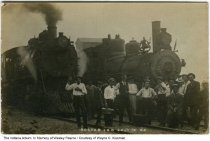 Image of Men posing by railroad train engines, Boston, Indiana, July 12, 1908 -  A group of men, including railroad workers, pose by train engines identified as Chesapeake and Ohio freight engines.