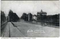 Image of Main Street seen from the river bridge, Cambridge City, Indiana, ca. 1900s -
