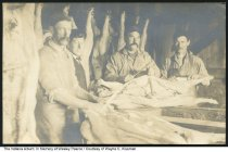 Image of Men working in a slaughterhouse, Williamsburg, Indiana, ca. 1910s - Four men are seen slaughtering a hog in the old slaughterhouse in WIlliamsburg. They are (L-R) unknown, Grant Watkins, Jim Thompson (the previous two were butchers), and Al Franklin.